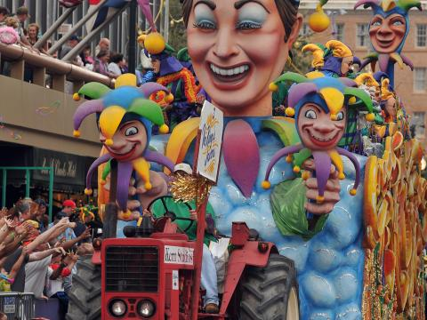 A colorful Mardi Gras float parades through the street in New Orleans, Louisiana